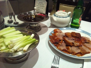 Peking duck with its traditional accompaniments.
